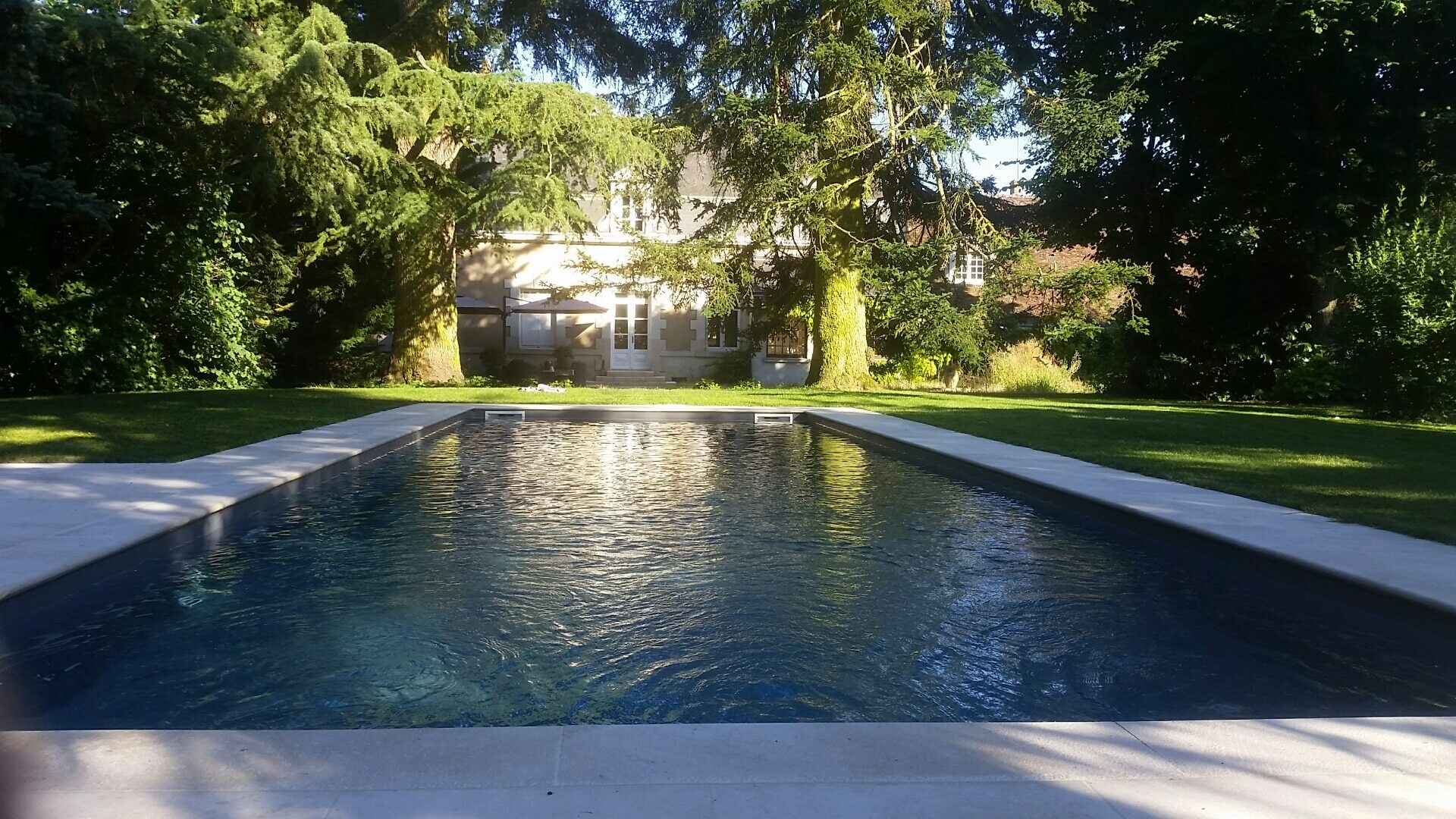 Photo de la piscine de la maison d'hôte
